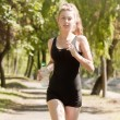 Girl running in the park — Stock Photo #21634535