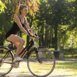 Girl riding a bike — Stockfoto