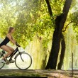 Girl riding a bike — Stock Photo #21634543
