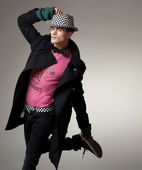 Pretty young male model jumping - studio shoot, copy space — Stock Photo