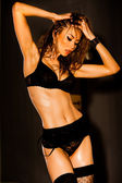 Hot woman in lingerie with sexy body posing glamorous in the stu — ストック写真
