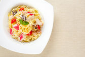 Delicious pasta with chees and tomatos on plate — Stock Photo