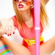 Stock Photo: Sexy baseball girl wearing colorfull clothes posing with a baseball bat
