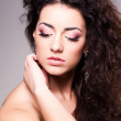 Cute girl with curly hair wearing make-up - studio shot — Stock Photo #24958795