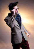 Fashion man model dressed casual posing dramatic - intentional motion blur — Stock Photo
