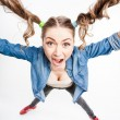 Cute funny girl with two pony tails smiling - wide angle shot — Stock Photo #24960137