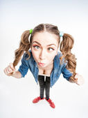 Cute funny girl with two pony tails smiling - wide angle shot — Stock Photo