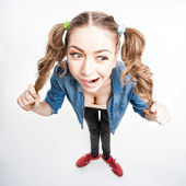 Cute funny girl with two pony tails - wide angle shot — Stock Photo