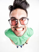 Funny handsome man with hipster glasses smiling - wide angle shot — Stock Photo
