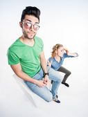 Pretty couple dressed casual arguing - view from above wide angle shot — Stock Photo