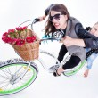 Two girls riding a bike making funny faces - isolated on bluish background — Stock Photo #28865639