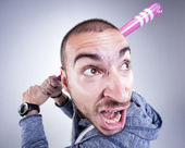 Funny hooligan with a pink baseball bat screaming in the studio — Stock Photo