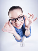 Pretty girl with perfect teeth wearing geek glasses smiling — Stock Photo