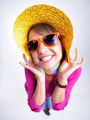 Cute girl with funny hat smiling in the studio — Stock Photo