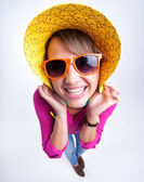 Pretty girl with funny hat smiling in the studio — Stock Photo