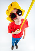 Funny guy dressed colorful and crazy holding a measuring tape — Stock Photo