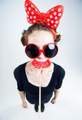 Cute girl with a big red lollipop and funny sunglasses — Stock Photo