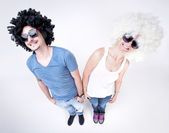 Funny couple wearing wigs smiling large - fish eye shot — Stock Photo