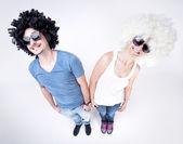 Funny couple wearing wigs smiling large - fish eye shot — Stock Photo