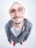 Funny man with big glasses cross looking and smiling — Stock Photo