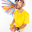 Funny man holding a glass of juice wearing sun glasses and yellow t shirt on white  — Stock Photo