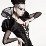Beautiful model posing as chess queen — Stock Photo