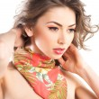 Beautiful woman wearing an colorful scarve — Stock Photo #29349271