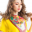 Beautiful woman wearing an colorful scarve — Stock Photo