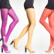 Collection of colorful stockings on sexy woman legs isolated on grey — Stock Photo #29351313