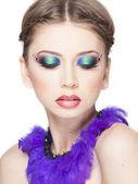 Beautiful model wearing blue make-up - studio shot isolated on white — Stock Photo