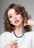 Pretty woman wearing scarf -studio shot on grey background — Stock Photo