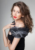 Pretty woman wearing scarf -studio shot on grey background — Stock Photo