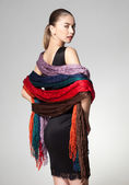 Woman wearing a collection of scarves — Stock Photo