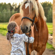 Girl with horse — Stock Photo #21307447