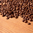 Stock Photo: Coffee beon wooden background
