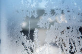 Ice patterns on winter glass — Stockfoto