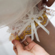 Garter on the leg of a bride - Stock Photo