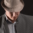 A man in a grey hat — Stock Photo