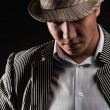 Stock Photo: The man in style Chicago gangster on dark background