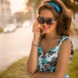American redhead girl in suglasses. Photo in 60s style. — Stock Photo