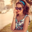 American redhead girl in suglasses. Photo in 60s style. — Stock Photo #32278017