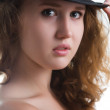Sensual girl in a hat with a beautiful naked body. — Stock Photo