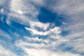 Blue sky with clouds closeup — Stock Photo