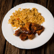 Delicious rice with chicken sauce, selective focus — Stock Photo