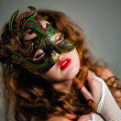 Beautiful Girl in Carnival mask with long curly hair. Masquerade Holidays — Stock Photo