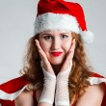 Pretty Santa girl closeup portrait, holding present gift box isolated on white background — Stock Photo #35367291