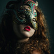 Beautiful Girl in Carnival mask with long curly hair. Masquerade Holidays — Stock Photo #37782431