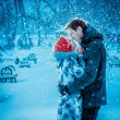 Happy Young Couple in Winter Park having fun.Family Outdoors. love kiss — Stock Photo #37782775