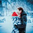 Happy Young Couple in Winter Park having fun.Family Outdoors. love kiss — Stock Photo