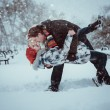 Happy Young Couple in Winter Park having fun.Family Outdoors. love kiss — Stock Photo #37782843